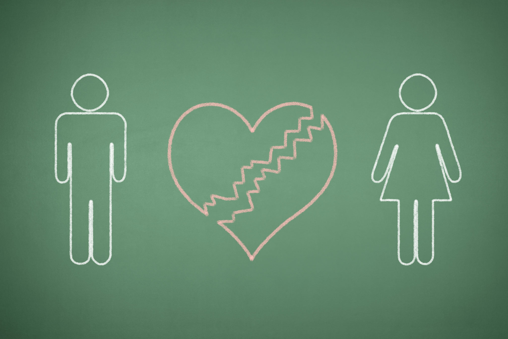 The Male And Female Bathroom Symbols With A Broken Heart Between